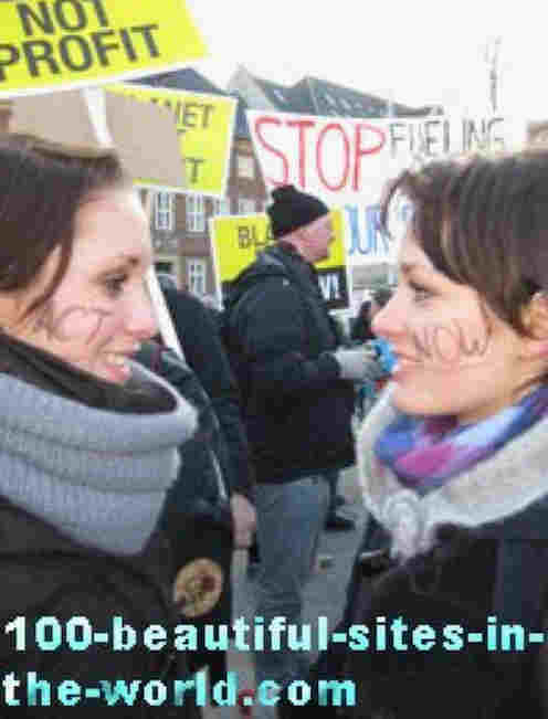 100-beautiful-sites-in-the-world.com/copenhagen-climate-demonstration.html: Copenhagen Climate Demonstration: Beautiful chicks call STOP FUELING and share ACT NOW by lipstick on their cheeks.