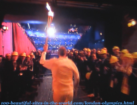 London Olympics 2012. An athlete taking London Olympics-torch to the stadium