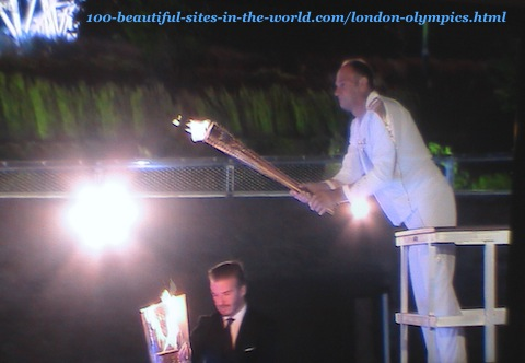 London Olympics 2012. Lighting the first torch from the torch that arrived by boat