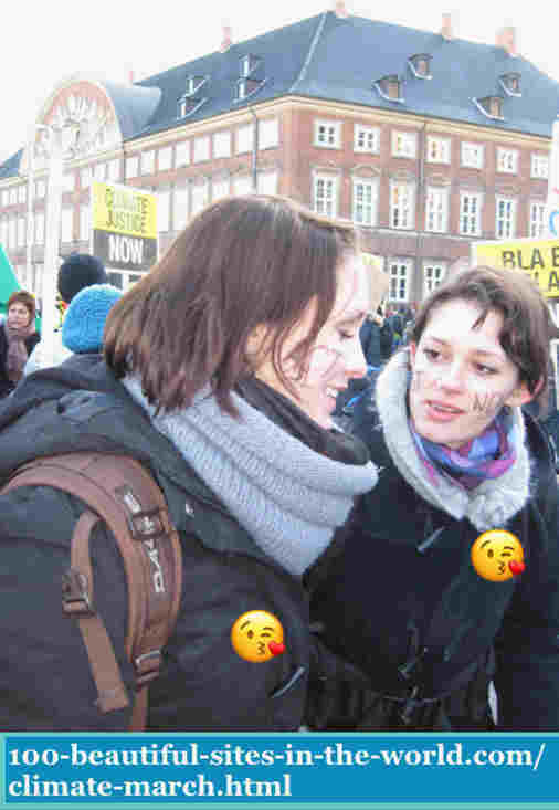 100-beautiful-sites-in-the-world.com/climate-march.html: Climate March:  in Copenhagen on 12/12/2009. Two chicks with