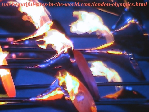 London Olympics 2012. Lighting the main torch from its 205 copper petals before launching it high
