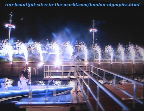 London Olympics 2012. After lighting the torch from the torch on the boat and walking towards the celebrations